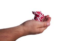 Red poker chips on the hand Stock Image