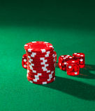 Red poker chips and red dice Royalty Free Stock Photo