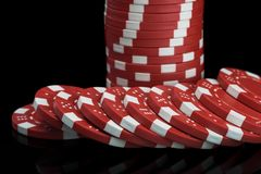 Red poker chips stacked close-up on a black background stock photos