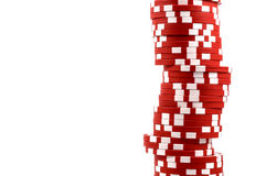 Red poker chips stacked in a line Stock Photo