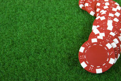 Red poker cihps. Red poker chips on green background Royalty Free Stock Images