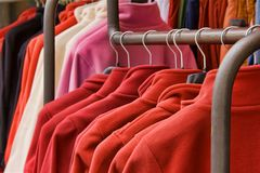 Red polar fleece jackets. Fleece jackets hanging on clothes hangers Royalty Free Stock Photos