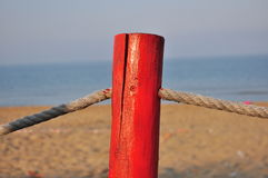 Red pole on the beach Royalty Free Stock Photography