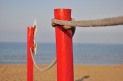 Red pole on the beach Stock Image
