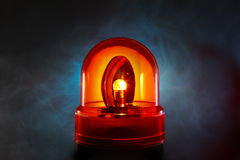 Red police light. Bright red police light glows through a foggy night Royalty Free Stock Image