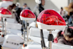 Red police light. Closeup of red police light, police siren, policewoman's motorcycles Royalty Free Stock Images