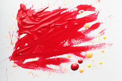 Red polish smears on white background. Top view on varnish bloody stains, free space. Cosmetic, makeup, beauty, fashion concept Royalty Free Stock Photo