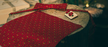 Red polka dot bow tie and cufflinks on wooden present box Royalty Free Stock Photography
