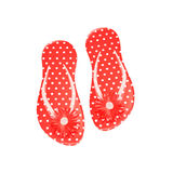 Red polka dot flip flops with flowers isolated on white. Summer concept Royalty Free Stock Photography