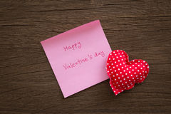 Red polka dot hearts with valentine note on wood texture Royalty Free Stock Photos
