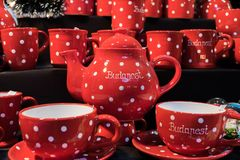 Red polka dot tea pottery set for sale royalty free stock image