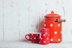 Red polka dot utensils. Red polka dot vintage kitchen utensils on a white talbe Royalty Free Stock Image