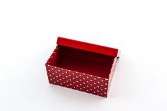 Red polka dots box on white background. Stock Photos