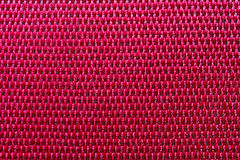 Red polyester macro. Texture of red polyester macro Royalty Free Stock Photo