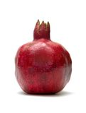 Red pomegranate. Isolated pomegranate against white background royalty free stock image