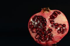 Free Red Pomegranate Against A Black Background Low Key Lighting Royalty Free Stock Photography - 163482537