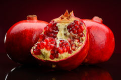 Red pomegranate on dark background Stock Images