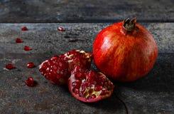 Red pomegranate on dark background Stock Image
