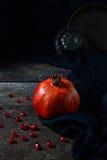 Red pomegranate on dark background Royalty Free Stock Photo