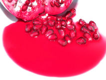 Red Pomegranate Juice and Seeds Royalty Free Stock Image