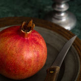 Red Pomegranate On A Pewter Plate Royalty Free Stock Photography