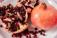 Red pomegranate . Red seeds. Health. Life. Royalty Free Stock Photography