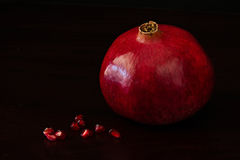 Red pomegranate with seeds Royalty Free Stock Photo