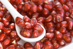 Red Pomegranate with spoon, macro Stock Image