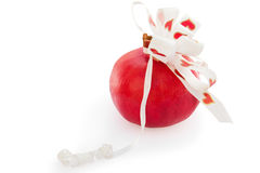 Red pomegranate with white bow at heart Stock Image