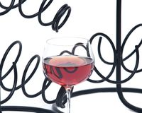 Red pomegranate wine in glass and metal wine bottle holder Royalty Free Stock Images