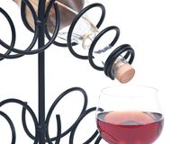 Red pomegranate wine, wine straw bottle and iron wine bottle holder Royalty Free Stock Images