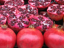 Red Pomegranates. Perfect Pomegranates, some of them sliced and some complete. This juicy pomegranate ready to be eaten Stock Photos