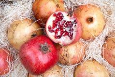 Red pomegranates in box Royalty Free Stock Photo