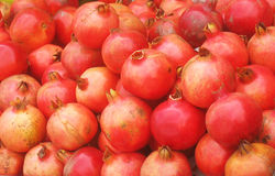Red Pomegranetes. A bunch of red colored fresh pomegranates for sale Stock Image