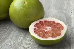Red pomelo fruit. Fresh red whole and half pomelo fruit Stock Photos