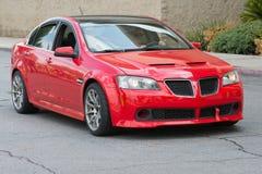 Red Pontiac G8 car on display Stock Photography