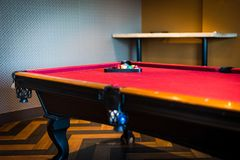 Red pool table, low angled view stock photo