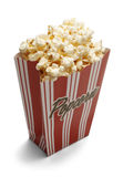 Popcorn Box. Red Popcorn Box with Yellow Popcorn isolated on a white background stock images