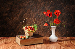 Red poppies in a vase and sweet cherry Royalty Free Stock Images