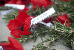 Red poppy anzac day remembrance day. Poppies on remembrance and Anzac day with rosemary and tags lest we forget Stock Photos