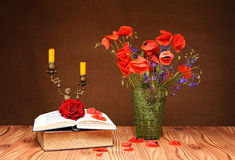 Red Poppy, book and candlestick Stock Images