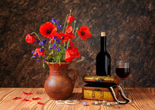 Red poppy in a ceramic vases and jewelry Stock Images