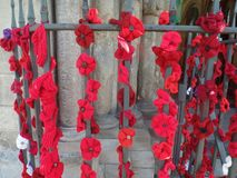Red poppy display outside a church royalty free stock image