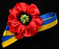 Red poppy flowers and ribbon Ukrainian flag stock image