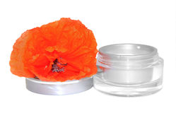 Red poppy jar with cream isolated on white background. Feminine,. Beauty and cosmetics concept Royalty Free Stock Photo