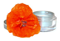Red poppy jar with cream isolated on white background. Feminine,. Beauty and cosmetics concept Royalty Free Stock Photos