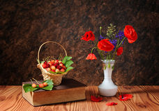 Red poppy in a vase and cherries Stock Photography