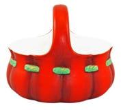 Porcelain basket. Red porcelain basket with handle Royalty Free Stock Images