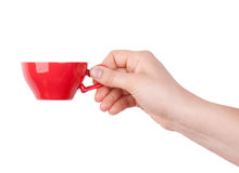 Red porcelain cup with coffee in hand Royalty Free Stock Photos