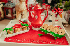 Red porcelain teapot and cookies Stock Image